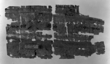 <em>Papyrus Fragments Inscribed in Demotic</em>, 1st-2nd century C.E. Papyrus, ink, Glass: 7 1/8 x 11 5/8 in. (18.1 x 29.5 cm). Brooklyn Museum, Charles Edwin Wilbour Fund, 37.1797E (Photo: Brooklyn Museum, 37.1797E_negB_bw_IMLS.jpg)