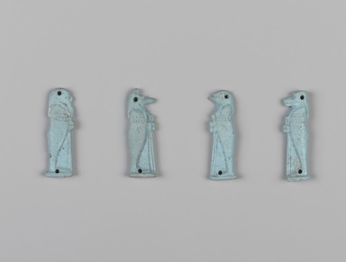 <em>Four Sons of Horus Amulets</em>, 381-343 B.C.E. Faience, 37.1806Ea: 1 9/16 x 1/2 x 3/16 in. (4 x 1.2 x 0.5 cm). Brooklyn Museum, Charles Edwin Wilbour Fund, 37.1806Ea-d. Creative Commons-BY (Photo: , 37.1806Ea-d_PS9.jpg)