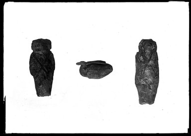 <em>Small Figures from the Sets of the Sons of Horus</em>. Wax, Jackal-headed: 2 7/16 x 7/8 x 3/8 in. (6.2 x 2.2 x 1 cm). Brooklyn Museum, Charles Edwin Wilbour Fund, 37.1807Ea-b. Creative Commons-BY (Photo: , 37.1807Ea-b_37.1809E_GrpA_SL4.jpg)