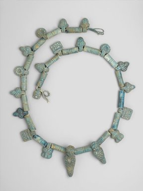 <em>Necklace from a Statue</em>, 664-332 B.C.E. Faience, glazed, 1 5/8 x 52 in. length (4.2 x 132.1 cm). Brooklyn Museum, Charles Edwin Wilbour Fund, 37.1824E.1-.43. Creative Commons-BY (Photo: Brooklyn Museum, 37.1824E.1-.43_PS1.jpg)