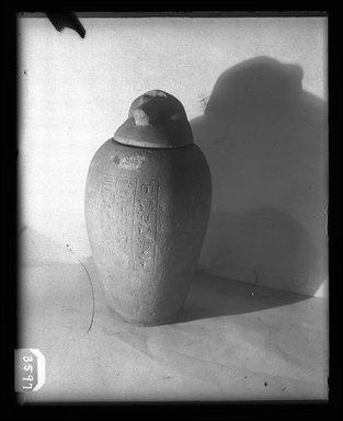 <em>Canopic Jar with Cover</em>. Limestone, 37.1899Ea: 9 7/16 x diam. 6 7/8 in. (24 x 17.5 cm). Brooklyn Museum, Charles Edwin Wilbour Fund, 37.1899Ea-b. Creative Commons-BY (Photo: Brooklyn Museum, 37.1899Ea-b_NegA_SL4.jpg)