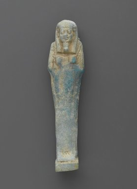 <em>Uninscribed Shabty</em>, 664-525 B.C.E. Faience, 4 1/8 x 1 x 3/4 in. (10.5 x 2.5 x 1.9 cm). Brooklyn Museum, Charles Edwin Wilbour Fund, 37.189E. Creative Commons-BY (Photo: Brooklyn Museum, 37.189E_front_PS2.jpg)