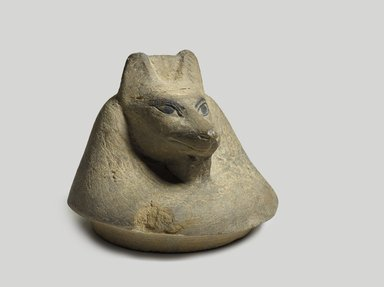 <em>Jackal-Headed Cover of Canopic Jar</em>, ca. 1075-332 B.C.E. Limestone, pigment, 3 3/4 x 4 5/8 x 4 5/8 in. (9.5 x 11.7 x 11.7 cm). Brooklyn Museum, Charles Edwin Wilbour Fund, 37.1907E. Creative Commons-BY (Photo: Brooklyn Museum, 37.1907E_PS9.jpg)
