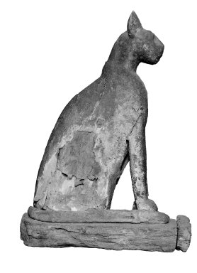 <em>Cat Coffin</em>, 664–332 B.C.E. Wood, gesso, pigment, linen, animal remains, 24 7/8 × 10 3/16 × 17 5/16 in. (63.2 × 25.9 × 44 cm). Brooklyn Museum, Charles Edwin Wilbour Fund, 37.1941E. Creative Commons-BY (Photo: Brooklyn Museum, 37.1941E_glass_SL1.jpg)
