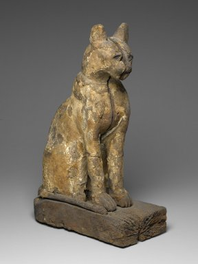 <em>Cat Coffin</em>, 664–332 B.C.E. Wood, gesso, linen, pigment, gold leaf, animal remains (Felis sylvestris, Felis libyca, or Felis chaus), 21 1/4 × 7 1/2 × 14 1/8 in. (54 × 19.1 × 35.9 cm). Brooklyn Museum, Charles Edwin Wilbour Fund, 37.1942E. Creative Commons-BY (Photo: Brooklyn Museum, 37.1942E_PS2.jpg)