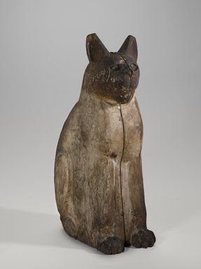 <em>Cat Coffin</em>, 664 B.C.E. or later. Wood, gesso, pigment, glass, animal remains, linen, 20 3/4 × 6 1/4 × 11 3/4 in. (52.7 × 15.9 × 29.8 cm). Brooklyn Museum, Charles Edwin Wilbour Fund, 37.1943E. Creative Commons-BY (Photo: Brooklyn Museum, 37.1943E_threequarter_PS9.jpg)
