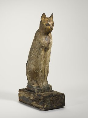 <em>Cat Coffin</em>, 664 B.C.E. or later. Wood, gesso, pigment, animal remains, 19 1/8 × 5 1/2 × 10 1/4 in. (48.6 × 14 × 26 cm). Brooklyn Museum, Charles Edwin Wilbour Fund, 37.1944Ea-b. Creative Commons-BY (Photo: Brooklyn Museum, 37.1944Ea-b_threequarter_PS9.jpg)