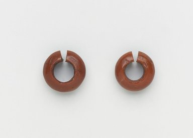 <em>Penannular Earring</em>, ca. 1539-1190 B.C.E. Red jasper, 5/16 × Diam. 11/16 in. (0.8 × 1.7 cm). Brooklyn Museum, Charles Edwin Wilbour Fund, 37.1958E. Creative Commons-BY (Photo: , 37.1957E_37.1958E_PS4.jpg)