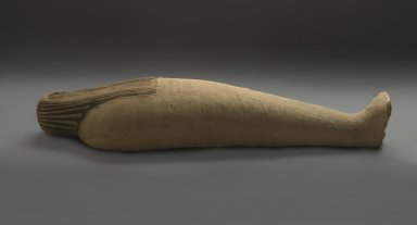 <em>Mummified Ibis</em>, 664-332 B.C.E. Animal remains, linen, 5 1/4 × 3 3/8 × 19 3/4 in. (13.3 × 8.6 × 50.2 cm). Brooklyn Museum, Charles Edwin Wilbour Fund, 37.1985E. Creative Commons-BY (Photo: Brooklyn Museum, 37.1985E_threequarter_PS2.jpg)
