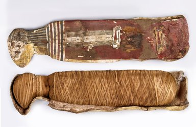 <em>Cat Mummy in Cartonnage</em>, ca. 760-390 B.C.E. Cartonnage, animal remains (Felis sylvestris, Felis libyca, or Felis chaus), linen, pigment, 9 1/2 x 6 x 35 in. (24.1 x 15.2 x 88.9 cm). Brooklyn Museum, Charles Edwin Wilbour Fund, 37.1991Ea-c. Creative Commons-BY (Photo: Brooklyn Museum (Gavin Ashworth,er), 37.1991Ea_37.1991Eb-c_Gavin_Ashworth_photograph.jpg)