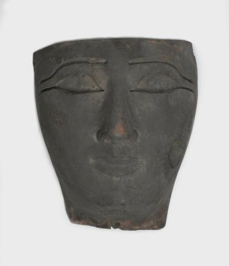 <em>Face from an Anthropoid Coffin</em>, 1075-656 B.C.E. Wood, 14 2/5 x 6 3/10 x 10 7/10 in. (36.6 x 16 x 27.2 cm). Brooklyn Museum, Charles Edwin Wilbour Fund, 37.2041.8E. Creative Commons-BY (Photo: Brooklyn Museum, 37.2041.8E_front_PS2.jpg)