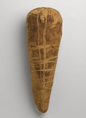 <em>Ibis Mummy</em>, 664–332 B.C.E. Animal remains, linen, 15 × 5 1/4 × 4 in. (38.1 × 13.3 × 10.2 cm). Brooklyn Museum, Charles Edwin Wilbour Fund, 37.2042.16E. Creative Commons-BY (Photo: Brooklyn Museum, 37.2042.16E_PS9.jpg)