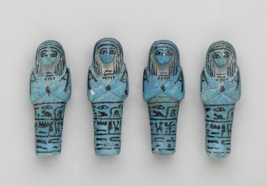 <em>Shabty of Princess Muthotep</em>, ca. 1075-656 B.C.E. Faience, 3 1/2 x 1 1/4 x 1 in. (8.9 x 3.2 x 2.5 cm). Brooklyn Museum, Charles Edwin Wilbour Fund, 37.207E. Creative Commons-BY (Photo: , 37.205E-.208E_front_PS2.jpg)