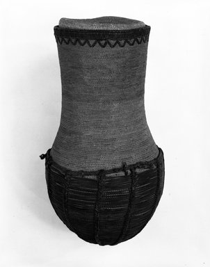 <em>Basket and Top</em>, early 20th century. Vegetable fiber, leather, height: 16 in. Brooklyn Museum, Gift of Mrs. Frederic B. Pratt, 37.206a-b. Creative Commons-BY (Photo: Brooklyn Museum, 37.206a-b_bw.jpg)