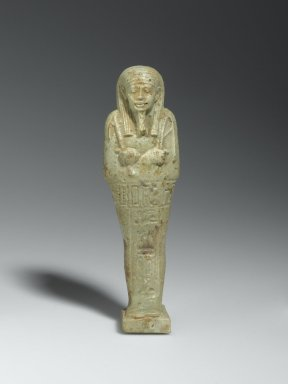 <em>Ushabti of the Priest Nesi-Kedwet</em>, 664-525 B.C.E. Faience, 5 11/16 x 1 9/16 x 1 3/16 in. (14.5 x 4 x 3 cm). Brooklyn Museum, Charles Edwin Wilbour Fund, 37.218E. Creative Commons-BY (Photo: Brooklyn Museum, 37.218E_front_PS2.jpg)