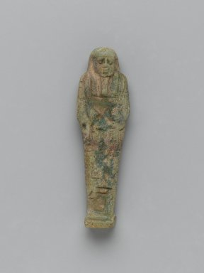 <em>Ushabti of Nesi-Yotf</em>, 664-343 B.C.E. Faience, 3 5/8 x 1 3/16 x 9/16 in. (9.3 x 3 x 1.5 cm). Brooklyn Museum, Charles Edwin Wilbour Fund, 37.225E. Creative Commons-BY (Photo: Brooklyn Museum, 37.225E_front_PS2.jpg)