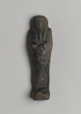 <em>Ushabti of Yuf-o</em>, 664-343 B.C.E. Faience, 3 9/16 x 7/8 x 1/2 in. (9 x 2.3 x 1.3 cm). Brooklyn Museum, Charles Edwin Wilbour Fund, 37.238E. Creative Commons-BY (Photo: Brooklyn Museum, 37.238E_front_PS2.jpg)