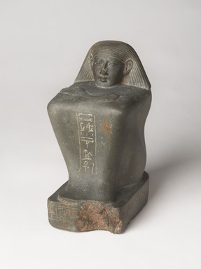 <em>Overseer of Weavers, Min</em>, ca. 1479-1425 B.C.E. Green siltstone or greywacke, 9 1/4 × 4 1/2 × 6 in., 14 lb. (23.5 × 11.4 × 15.2 cm, 6.35kg). Brooklyn Museum, Charles Edwin Wilbour Fund, 37.249E. Creative Commons-BY (Photo: , 37.249E_PS9.jpg)