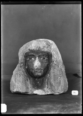 <em>Head of a Woman Wearing an Elaborate Wig</em>, ca. 1352-1190 B.C.E. Limestone, pigment, 6 3/4 × 4 3/4 × 7 1/4 in. (17.1 × 12.1 × 18.4 cm). Brooklyn Museum, Charles Edwin Wilbour Fund, 37.256E. Creative Commons-BY (Photo: Brooklyn Museum, 37.256E_NegB_SL4.jpg)