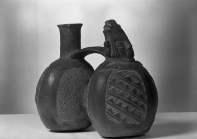 Chimú. <em>Double-chambered Whistling Jar with Human Figure</em>, ca.1100-1400. Ceramic, 7 5/16 x 8 in. (18.6 x 20.3 cm). Brooklyn Museum, Frank Sherman Benson Fund and the Henry L. Batterman Fund, 37.2571PA. Creative Commons-BY (Photo: Brooklyn Museum, 37.2571PA_acetate_bw.jpg)