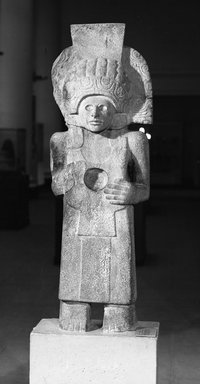 Huastec. <em>Figure of a Standing Male</em>, 900-1250. Sandstone, 52 3/4 x 17 in. (134 x 43.2 cm). Brooklyn Museum, Frank Sherman Benson Fund and the Henry L. Batterman Fund, 37.2898PA. Creative Commons-BY (Photo: Brooklyn Museum, 37.2898PA_installation_view1_acetate_bw.jpg)