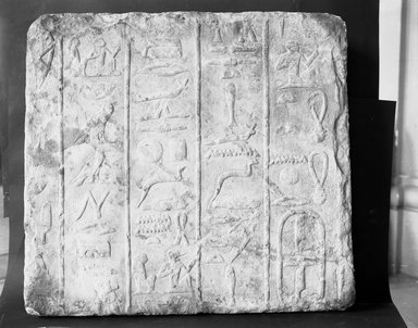 <em>Relief Fragment with Hieroglyphs</em>, ca. 2500-2350 B.C.E. Limestone, 20 3/16 x 21 5/8 x 4 3/4 in. (51.2 x 55 x 12 cm). Brooklyn Museum, Charles Edwin Wilbour Fund, 37.28E. Creative Commons-BY (Photo: Brooklyn Museum, 37.28E_NegC_glass_bw.jpg)