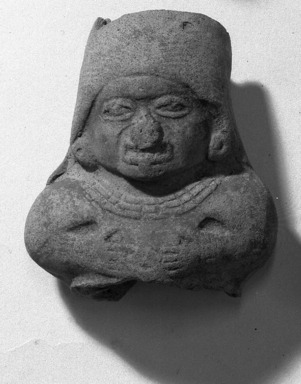 <em>Fragment of Hollow Figurine</em>. Gray clay Brooklyn Museum, Frank Sherman Benson Fund and Henry L. Batterman Fund, 37.3036PA. Creative Commons-BY (Photo: Brooklyn Museum, 37.3036PA_acetate_bw.jpg)