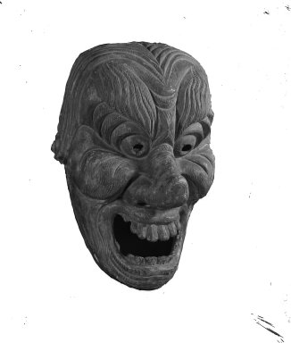 <em>Large Mask</em>, mid 14th-late 16th century. Grained wood, 12 x 16 15/16 in. (30.5 x 43.1 cm). Brooklyn Museum, Designated Purchase Fund and by exchange, 37.334. Creative Commons-BY (Photo: Brooklyn Museum, 37.334_acetate_bw.jpg)