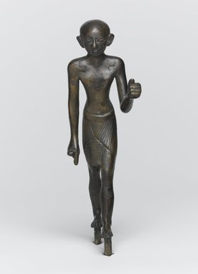 <em>Striding Figure of a Priest</em>, ca. 1070-656 B.C.E. Bronze, 4 13/16 x 1 5/16 x 1 3/4 in. (12.3 x 3.4 x 4.4 cm). Brooklyn Museum, Charles Edwin Wilbour Fund, 37.363E. Creative Commons-BY (Photo: Brooklyn Museum, 37.363E_front_PS1.jpg)