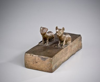 <em>Kitten Coffin</em>, 850-540 B.C.E. Bronze, animal remains, linen, 3 1/8 x 2 3/8 x 6 1/4 in. (8 x 6 x 15.8 cm). Brooklyn Museum, Charles Edwin Wilbour Fund, 37.369Ea-b. Creative Commons-BY (Photo: Brooklyn Museum (Gavin Ashworth,er), 37.369Ea_Gavin_Ashworth_photograph.jpg)