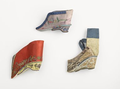 <em>Pair of Shoes for Women's Bound Feet</em>, 19th century. Embroidered satin-weave silk, thread, metal, wood, textile, paper. ribbon, 3 ¾ x 5 x 1 ½ in. each (overall). Brooklyn Museum, Frank L. Babbott Fund, 37.371.104.1-.2. Creative Commons-BY (Photo: , 37.371.104.1_44.2004_34.1496_PS9.jpg)