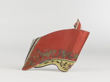 <em>Pair of Shoes for Women's Bound Feet</em>, 19th century. Embroidered satin-weave silk, thread, metal, wood, textile, paper. ribbon, 3 ¾ x 5 x 1 ½ in. each (overall). Brooklyn Museum, Frank L. Babbott Fund, 37.371.104.1-.2. Creative Commons-BY (Photo: Brooklyn Museum, 37.371.104.1_PS9.jpg)