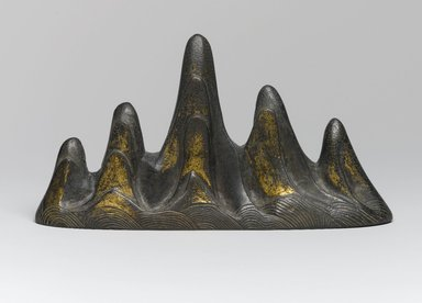 <em>Brush Rest in the Form of a Mountain</em>, 18th century (possibly). Bronze, traces of gilding, 3 7/8 x 1 11/16 x 7 1/16 in. (9.8 x 4.3 x 17.9 cm). Brooklyn Museum, Frank L. Babbott Fund, 37.371.13. Creative Commons-BY (Photo: Brooklyn Museum, 37.371.13_PS1.jpg)