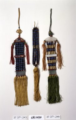 <em>Incense Bead Tassel (Norigae)</em>, 20th century. Beads, kingfisher feathers, silk, Overall length: 17 11/16 in. (45 cm). Brooklyn Museum, Frank L. Babbott Fund, 37.371.243. Creative Commons-BY (Photo: Brooklyn Museum, 37.371.243.jpg)