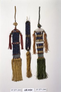 <em>Incense Bead Tassel (Norigae)</em>, 20th century. Gold, nephrite, kingfisher feathers, silk, Overall length: 15 in. (38.1 cm). Brooklyn Museum, Frank L. Babbott Fund, 37.371.246. Creative Commons-BY (Photo: Brooklyn Museum, 37.371.246.jpg)