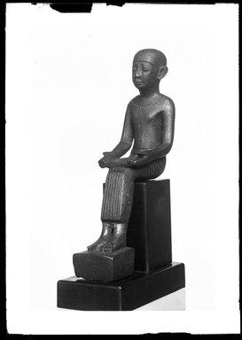 <em>Small Statue of Imhotep</em>, 305-30 B.C.E. Bronze, 4 1/2 x 1 3/16 x 2 5/16 in. (11.5 x 3 x 5.8 cm). Brooklyn Museum, Charles Edwin Wilbour Fund, 37.373E. Creative Commons-BY (Photo: Brooklyn Museum, 37.373E_NegA_SL4.jpg)