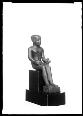 <em>Small Statue of Imhotep</em>, 305-30 B.C.E. Bronze, 3 7/8 x 1 1/8 x 1 7/8 in. (9.8 x 2.9 x 4.8 cm). Brooklyn Museum, Charles Edwin Wilbour Fund, 37.374E. Creative Commons-BY (Photo: Brooklyn Museum, 37.374E_NegA_SL4.jpg)