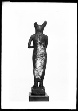 <em>Small Figurine of the Goddess Bast</em>. Bronze, 4 13/16 x 1 1/4 x 1 1/8 in. (12.3 x 3.3 x 2.8 cm). Brooklyn Museum, Charles Edwin Wilbour Fund, 37.377E. Creative Commons-BY (Photo: Brooklyn Museum, 37.377E_NegD_SL4.jpg)