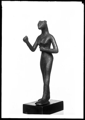 <em>Small Figurine of the Goddess Bast</em>. Bronze, 4 15/16 x 1 9/16 x 1 11/16 in. (12.6 x 3.9 x 4.3 cm). Brooklyn Museum, Charles Edwin Wilbour Fund, 37.378E. Creative Commons-BY (Photo: Brooklyn Museum, 37.378E_NegA_SL4.jpg)