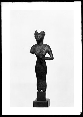 <em>Small Figurine of the Goddess Bast</em>, 305-30 B.C.E. Bronze, 3 11/16 x 1 7/16 x 1 in. (9.4 x 3.6 x 2.5 cm). Brooklyn Museum, Charles Edwin Wilbour Fund, 37.380E. Creative Commons-BY (Photo: Brooklyn Museum, 37.380E_NegA_SL4.jpg)