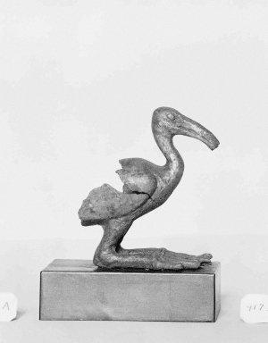 <em>Small Statue of an Ibis</em>, 305-30 B.C.E. Bronze, 3 5/16 x 1 1/8 x 2 3/16 in. (8.4 x 2.8 x 5.6 cm). Brooklyn Museum, Charles Edwin Wilbour Fund, 37.382E. Creative Commons-BY (Photo: Brooklyn Museum, 37.382E_glass_SL1.jpg)