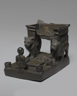 <em>Throne with Lions and Worshipper</em>, 664-332 B.C.E. Bronze, 3 1/16 x 3 7/8 x 2 9/16 in. (7.8 x 9.8 x 6.5 cm). Brooklyn Museum, Charles Edwin Wilbour Fund, 37.418E. Creative Commons-BY (Photo: Brooklyn Museum, 37.418E_threequarter_PS9.jpg)