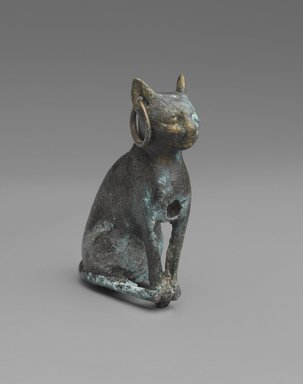 <em>Figurine of a Cat</em>, 664 B.C.E. or later. Bronze, Height (without tang) 2 7/16 x 7/8 x 1 5/8 in. (6.2 x 2.2 x 4.1 cm). Brooklyn Museum, Charles Edwin Wilbour Fund, 37.425E. Creative Commons-BY (Photo: Brooklyn Museum, 37.425E_PS9.jpg)