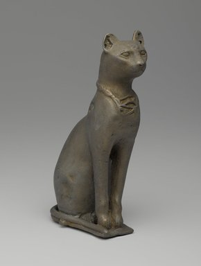 <em>Statuette of a Cat</em>, 332-30 B.C.E. Bronze, 5 9/16 x 2 1/16 x 3 1/8 in. (14.2 x 5.2 x 8 cm). Brooklyn Museum, Charles Edwin Wilbour Fund, 37.427E. Creative Commons-BY (Photo: Brooklyn Museum, 37.427E_PS9.jpg)