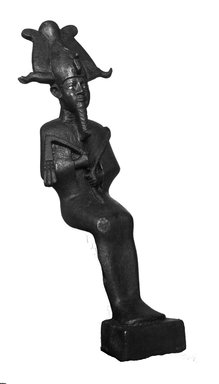 <em>Seated Statue of Osiris Carrying a Crook and Flail</em>, 664-332 B.C.E. Bronze, 7 7/16 × 2 1/2 × 4 in. (18.9 × 6.4 × 10.1 cm). Brooklyn Museum, Charles Edwin Wilbour Fund, 37.430E. Creative Commons-BY (Photo: Brooklyn Museum, 37.430E_NegB_glass_bw_SL4.jpg)