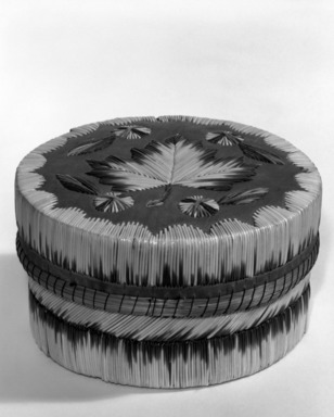 Anishinaabe. <em>Circular Box with Maple Leaf Design on the Cover</em>, early 20th century. Wood bark, porcupine quills, string, reed, 5 3/4 x 3 3/8 in. or (8.5 x 14.5 cm). Brooklyn Museum, Museum Collection Fund, 37.431a-b. Creative Commons-BY (Photo: Brooklyn Museum, 37.431a-b_bw.jpg)
