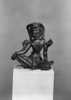 <em>Indra</em>, 17th century. Gilt copper sculpture, 5 1/8 x 4 1/2 x 3 1/8 in. (13 x 11.5 x 8 cm). Brooklyn Museum, Ella C. Woodward Memorial Fund and Museum Collection Fund, 37.467. Creative Commons-BY (Photo: Brooklyn Museum, 37.467_view1_acetate_bw.jpg)