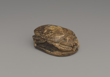 <em>Commemorative Lion Hunt Scarab of Amunhotep III</em>, ca. 1390-1352 B.C.E. Steatite, glaze, 1 5/16 x 2 5/16 x 3 7/16 in. (3.4 x 5.8 x 8.7 cm). Brooklyn Museum, Charles Edwin Wilbour Fund, 37.477E. Creative Commons-BY (Photo: Brooklyn Museum, 37.477E_threequarter_PS9.jpg)