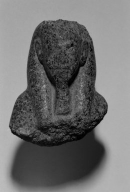 <em>Fragmentary Shabti of Akhenaten</em>, ca. 1352-1336 B.C.E. Black granite, 3 9/16 x  width at base 2 11/16 in. (9 x 6.8 cm). Brooklyn Museum, Charles Edwin Wilbour Fund, 37.508. Creative Commons-BY (Photo: Brooklyn Museum, 37.508_front_bw.jpg)