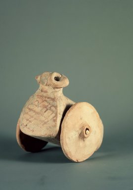Indus Valley Culture. <em>Wheel for a Toy Ram</em>, 3000-2500 B.C.E. Pottery, diameter: 3 1/8 in. (7.9 cm). Brooklyn Museum, A. Augustus Healy Fund, 37.51. Creative Commons-BY (Photo: , 37.50_37.51_37.52.jpg)